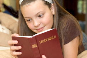 Girl reading her Bible