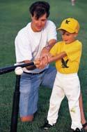 dad and son playing baseball